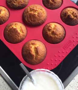 The picture shows a tray of lemon muffins
