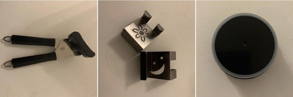 Das Bild zeigt einen Dosenöffner, zwei Türhaken und einen Deckel eines Thermosbehälters